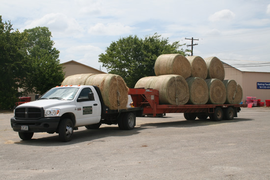loaded with quality hay and ready to hit the road for another great service of delivery